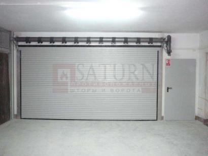 Рулонные автоматические пожарные ворота с калиткой